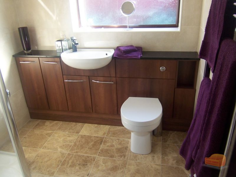 Fitted Walnut Units With Black Granite Worktop In Bathroom