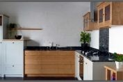 Chestnut and painted kitchen with cosmic black granite worktops