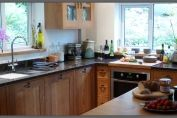 Faceframe oak kitchen with tan brown granite worktop