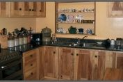 kitchen in spalted ash with tan brown granite worktop