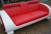 CURVED SOFA WITH PULL DOWN DRINKS HOLDER RED LEATHER